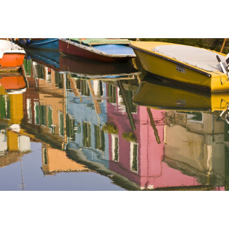 Italy, Burano. Boats on a canal with