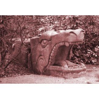 dragon statue mouth open stone faded reddish