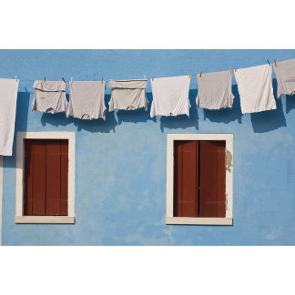 Italy, Burano. Hanging laundry and windows along