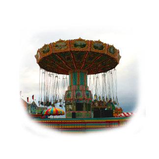Fairgrounds Swings Stopped Against Grey sky