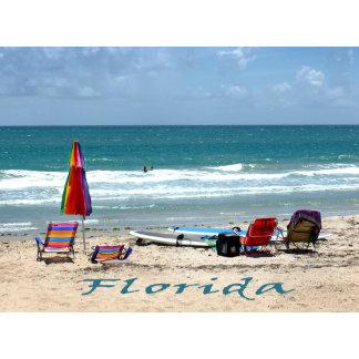 beach chairs surfboards umbrellas sand ocean flori