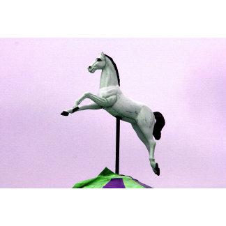 White carousel statue against purple sky