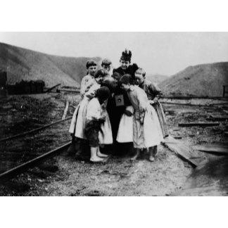 Children Looking at a Kodak Camera Photograph