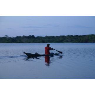 Amazonian native returning home at sunset