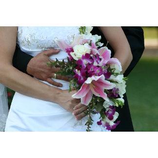 bride holding flowers groom behind painting