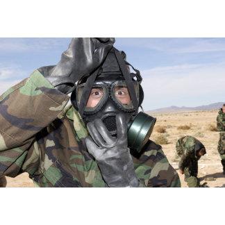 Rifleman puts on his gas mask