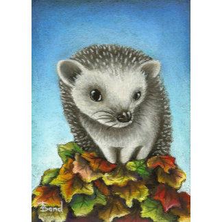 Little hedgehog on a big pile of leaves