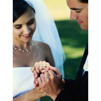 Bride and groom holding hands, close-up