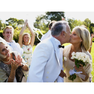 Bride and groom kissing wedding guests in