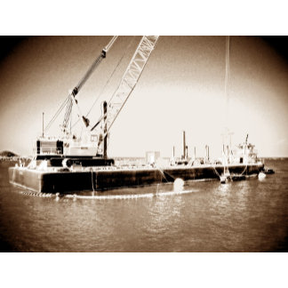 Floating barge and crane sepia toned