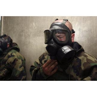A field radio operator clears CS gas