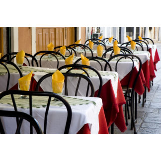 Italy, Venice. A row of colorful tables at an