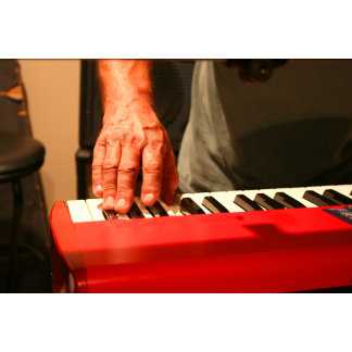hand playing red keyboard male music design