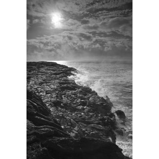 USA. Molten lava flows into the ocean at sunrise