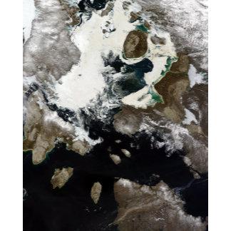 Sea ice and sediment visible in Nunavut, Canada
