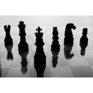 Chess pieces on chess board in black and white