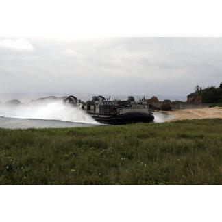 A landing craft air cushion comes ashore