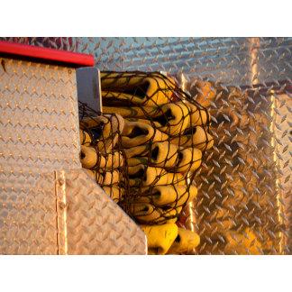 firehoses in net on fireman firetruck