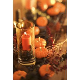 Candle and miniature pumpkins