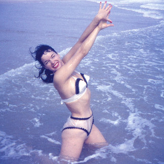 Bettie Page Playing in the Water at the Beach