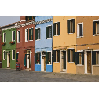 Italy, Burano. Colorful row of homes and empty