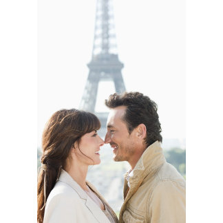 Romantic couple with the Eiffel Tower in the