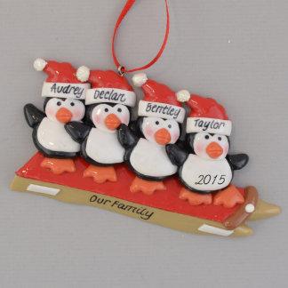 Four Penguins Sledding Personalized Ornament