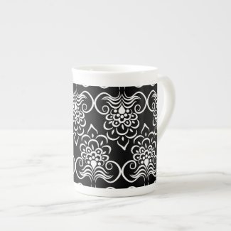 White Swirls Floral Pattern On Black Tea Cup