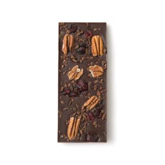 Semillas de la pacana, del arándano y de cacao barras de chocolate negro