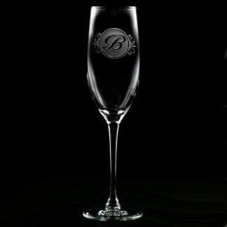 Flauta de champán con monograma de la escritura