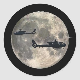 two helicopters silhouetted by a full moon classic round sticker