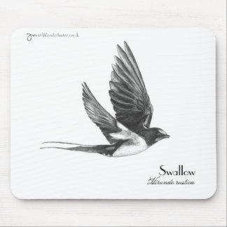 Swallow in flight mouse pad