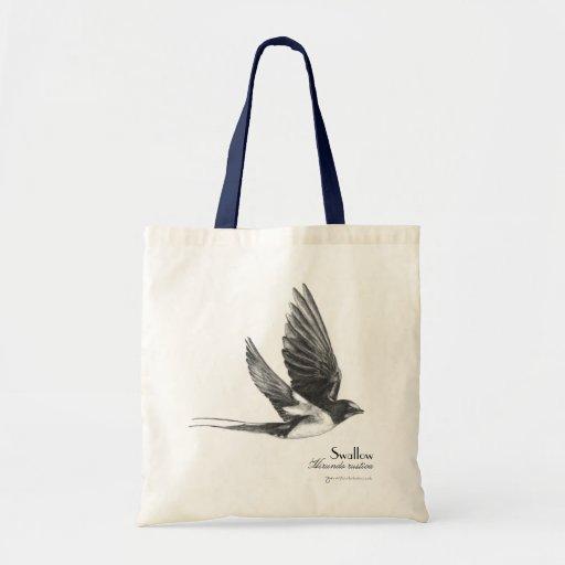 Swallow in flight tote bag