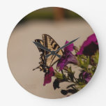 Swallowtail in the Petunias Round Wallclock