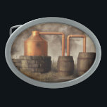 """Swamp Moonshine Still Belt Buckle<br><div class=""""desc"""">A copper pot still churns away in a misty swamp. Dark smoke billows from the furnace while moonshine trickles into a jug from the worm. It looks like the moonshiner has run off though. Once should never leave a still alone when distilling. Actually, this would not be a particularly practical...</div>"""