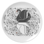 swans black and white in front of a kaleidoscope dinner plate