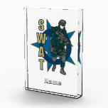 """SWAT Police Officer Acrylic Award<br><div class=""""desc"""">Great police SWAT gift featuring a fully loaded SWAT team member ready to pulling his sidearm! Light blue star background with dark blue circle and tan SWAT text on the left! Special Weapons and Tactics shirts and gifts for law enforcement members,  supporters,  friends and family!</div>"""
