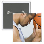 sweating man leaning forehead on basketball pinback button