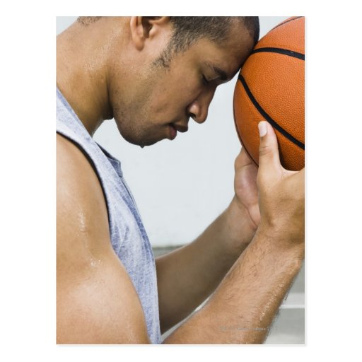 sweating man leaning forehead on basketball postcard