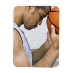 sweating man leaning forehead on basketball rectangular photo magnet