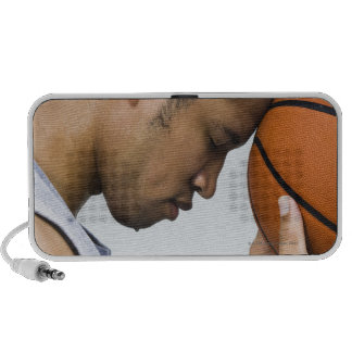 sweating man leaning forehead on basketball travel speaker