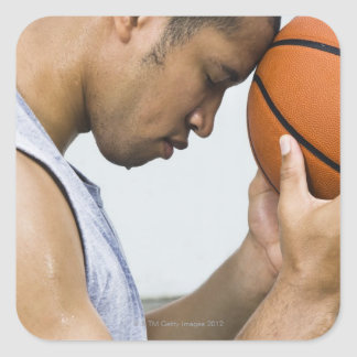 sweating man leaning forehead on basketball square sticker