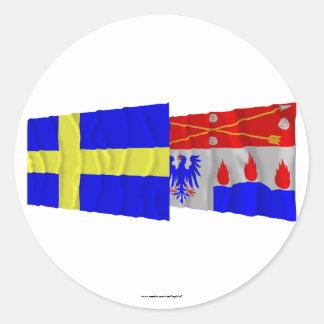 Sweden and Örebro län waving flags Round Sticker