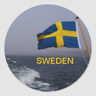 Swedens flag in the wind classic round sticker