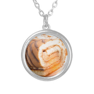 Sweet cake with chocolate cream and cup of hot tea silver plated necklace