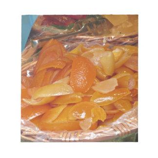 Sweet candied orange peels . Italian recipe Notepad