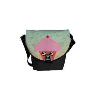 Sweet Kawaii Cupcake on a Hearts Background Courier Bags