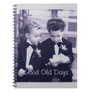 Sweet Little grooms in suit reading letter Notebook