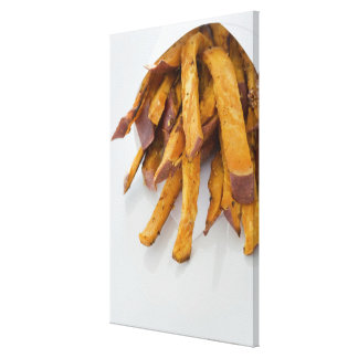 Sweet Potato fries in paper bag, close up, Canvas Print