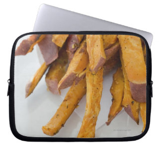 Sweet Potato fries in paper bag close up Computer Sleeve
